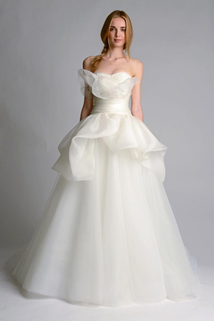 Flouncy strapless wedding dress