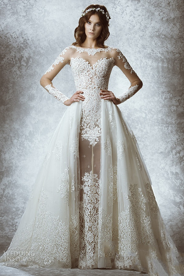 long sleeved transparent lace wedding dress with detachable chapel tailling